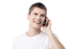 Hello, when you come here mate ?. Young handsome man talking on cell phone Stock Images