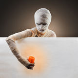 Halloween mummy with a candle. Invites on party. Space for text Stock Photography