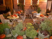 Helloween night. Magic helloween night, orange pumpkin 🎃 in restaurant, white tables, wonderful day Stock Photo
