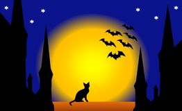 Helloween night in the old town. View of some symbols - starlit night, a black cat, bats, an old medieval town, full shining moon - that can symbolyze  helloween Stock Photo