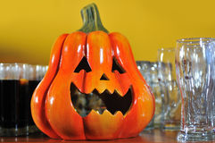 Helloween party pumpkin glasses. Helloween party pumpkin and glasses closeup Stock Images
