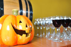 Helloween party pumpkin and wine glasses. Close up Stock Image
