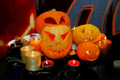Helloween (pumpkin). Images characters Helloween - candles and carved pumpkins from the birth of monsters Stock Photo