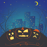 Helloween pumpkin. Halloween. Three pumpkins glowing at night in a dark city Stock Photo