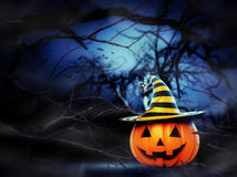 Helloween pumpkin in the forest. Helloween pumpkin in the spooky night forest Royalty Free Stock Images