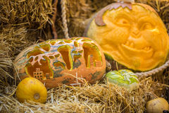Helloween pumpkin. On hay at old wooden farm house Stock Image