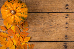 Helloween pumpkins over an old rustic vintage table. Top view, copy space Royalty Free Stock Images