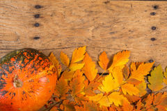 Helloween pumpkins over an old rustic vintage table Royalty Free Stock Photo