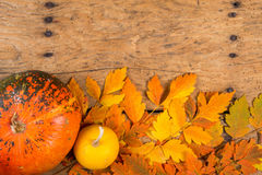 Helloween pumpkins over an old rustic vintage table Stock Image