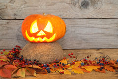 Helloween pumpkins over an old rustic vintage table Royalty Free Stock Photography