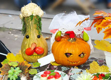 Helloween vegetables pumpkin composition concept. On autumn leaves and a carpet background Royalty Free Stock Image
