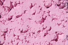 Hellrosa Farbpulverhintergrund Helle Farben für indisches holi Festival Buntes gulal, kosmetisches Pulver selektiver Fokus, stockbild