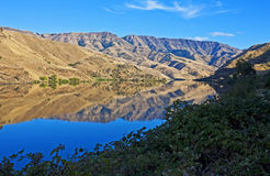Hells Canyon with Snake River. Evening panorama with reflections along the Snake River in Hells Canyon on the Oregon-Idaho border stock image