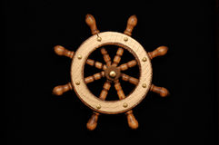 Helm. A ship helm or steering wheel on a black background Stock Images