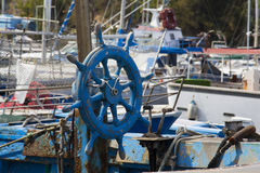 The helm of a boat. Cagliari: Detail of a fishing boat docked in the marina of Marina Piccola - Sardinia Stock Image