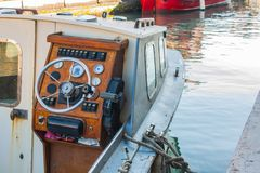 Helm of a boat, vintage wooden navigation panel with steering wh Royalty Free Stock Photo