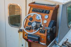 Helm of a boat, vintage wooden navigation panel with steering wheel Stock Images