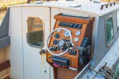 Helm of a boat, vintage wooden navigation panel with steering wheel Royalty Free Stock Photography