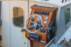 Helm of a boat, vintage wooden navigation panel with steering wh Stock Image