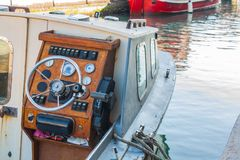 Helm of a boat, vintage wooden navigation panel with steering wh Royalty Free Stock Images