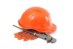 Helm, handschoenen en aapmoersleutel Stock Afbeeldingen