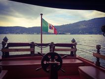 Helm and italian marine flag on a boat of Lake Maggiore Stock Image