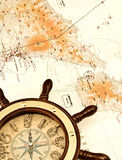 Helm on the map. Conceptual image of travel,exploration or adventure, in light sepia style Stock Photography