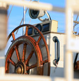 Old helm on sailing ship in morning light Stock Images