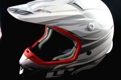 Helmet 7. Silver, white and red, dirt bike, off-road bike helmet, on black background Stock Images