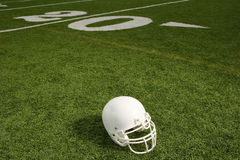 Helmet on American football field Royalty Free Stock Photography