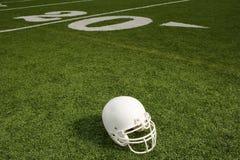 Helmet on American football field Royalty Free Stock Photography