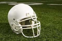 Helmet on American football field Stock Photo