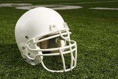 Helmet on American football field Stock Photo