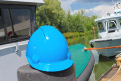 Helmet amid built ships Royalty Free Stock Photos