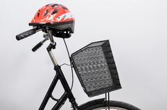 Helmet on a bicycle with a basket. stock photography