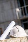Helmet and blueprints. Royalty Free Stock Photo