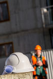 Helmet, blueprints and construction worker Stock Image