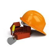Helmet with bricks and trowel Stock Photos