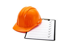 Helmet and clipboard Stock Images