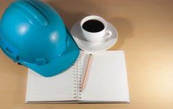 Helmet, coffee, on the desk, anytime. stock photo