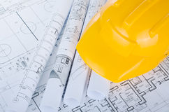 Helmet on the construction drawings isolated Royalty Free Stock Image
