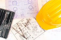 Helmet and construction plans Stock Photo