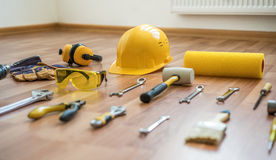 Helmet with construction tools Stock Photos