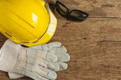 Helmet and construction tools royalty free stock photography