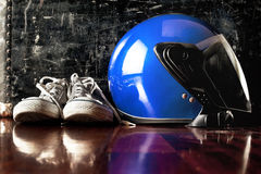 Helmet and dirty sneakers Stock Image