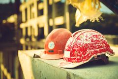 Helmet Engineering Construction worker equipment on background. Safety Helmet Engineering Construction worker equipment. Forgotten builder helmet lying on a stock photos
