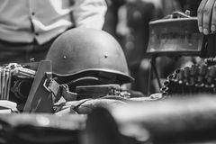 Military helmet lies. Helmet and equipment of the second World war are in the trench on a camouflage cloak royalty free stock images