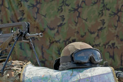 Helmet, FAMAS and map. On a background of camouflage tent Royalty Free Stock Photography