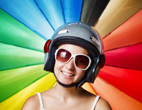 Funny girl in helmet having fun Royalty Free Stock Image