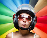 Funny girl in helmet having fun Stock Photography